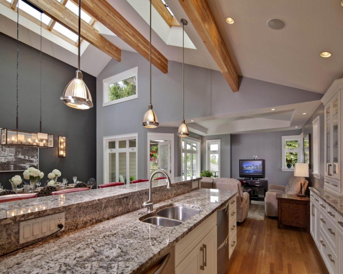 Compact As It May Seem This Seemingly Spacious Kitchen Was Achieved Because Of The Vaulted Ce Vaulted Ceiling Kitchen Vaulted Ceiling Lighting Kitchen Ceiling