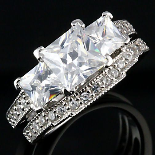 PRODUCT DESCRIPTION: Shekira: The Shekira is an absolutely stunning 2-piece Past, Present, Future Wedding Ring set featuring flawless Radiant Princess-cut Ice on Fire Russian CZ gemstones set into an