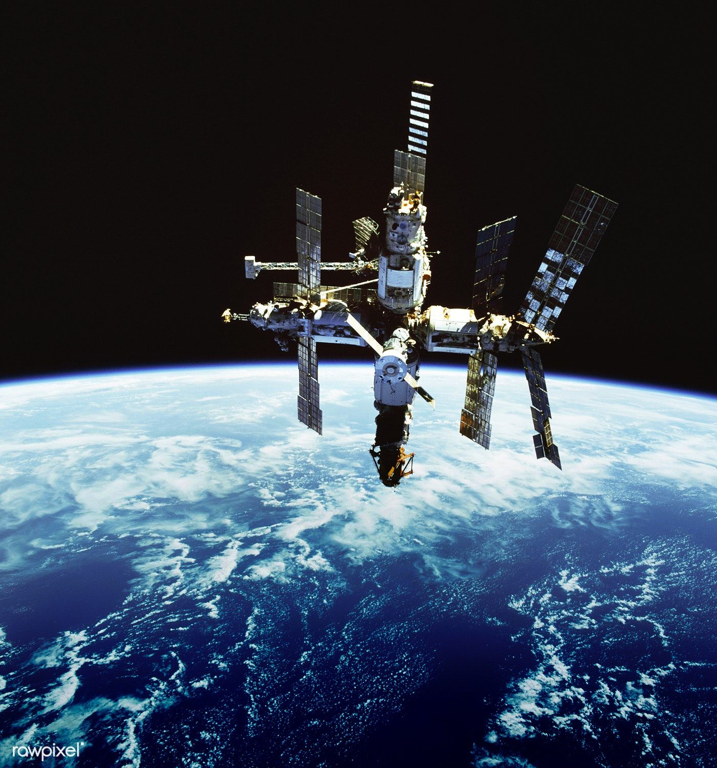 Russia's Mir space station is backdropped against Earth's horizon ...