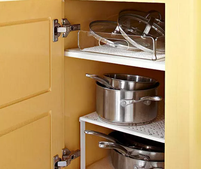 Add An Extra Level Of Storage To A Cupboard By Popping In A Riser Kitchen Guarantee Kitchen Organization Kitchen Cabinet Organization Kitchen Cabinet Shelves