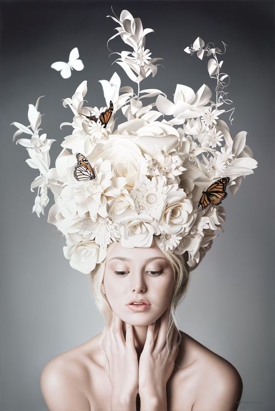 Like the way different flower shapes and butterflies have been used to create a beautiful flower crown. Could use this for either a shape for a hat or details: