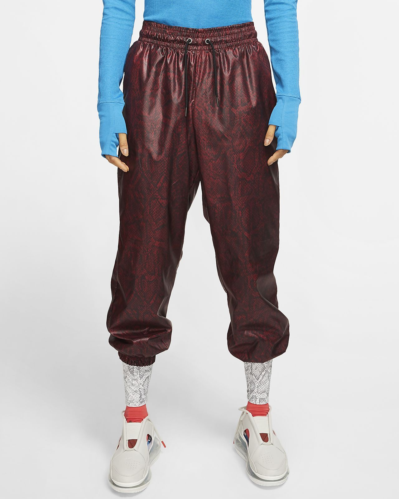 Photo of Nike Sportswear Women's Woven Pants. Nike.com