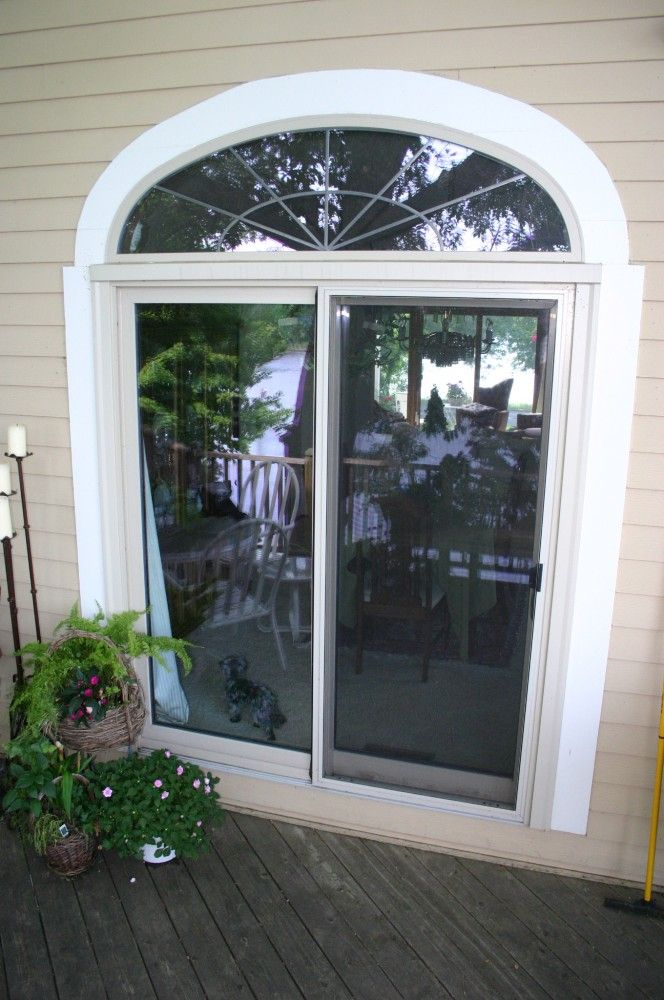 Make a statement with a half circle window above the patio door