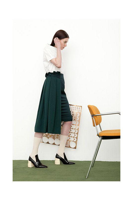Therese Skirt in dark green viscose blend worn over Sibyl Top in white cotton poplin.