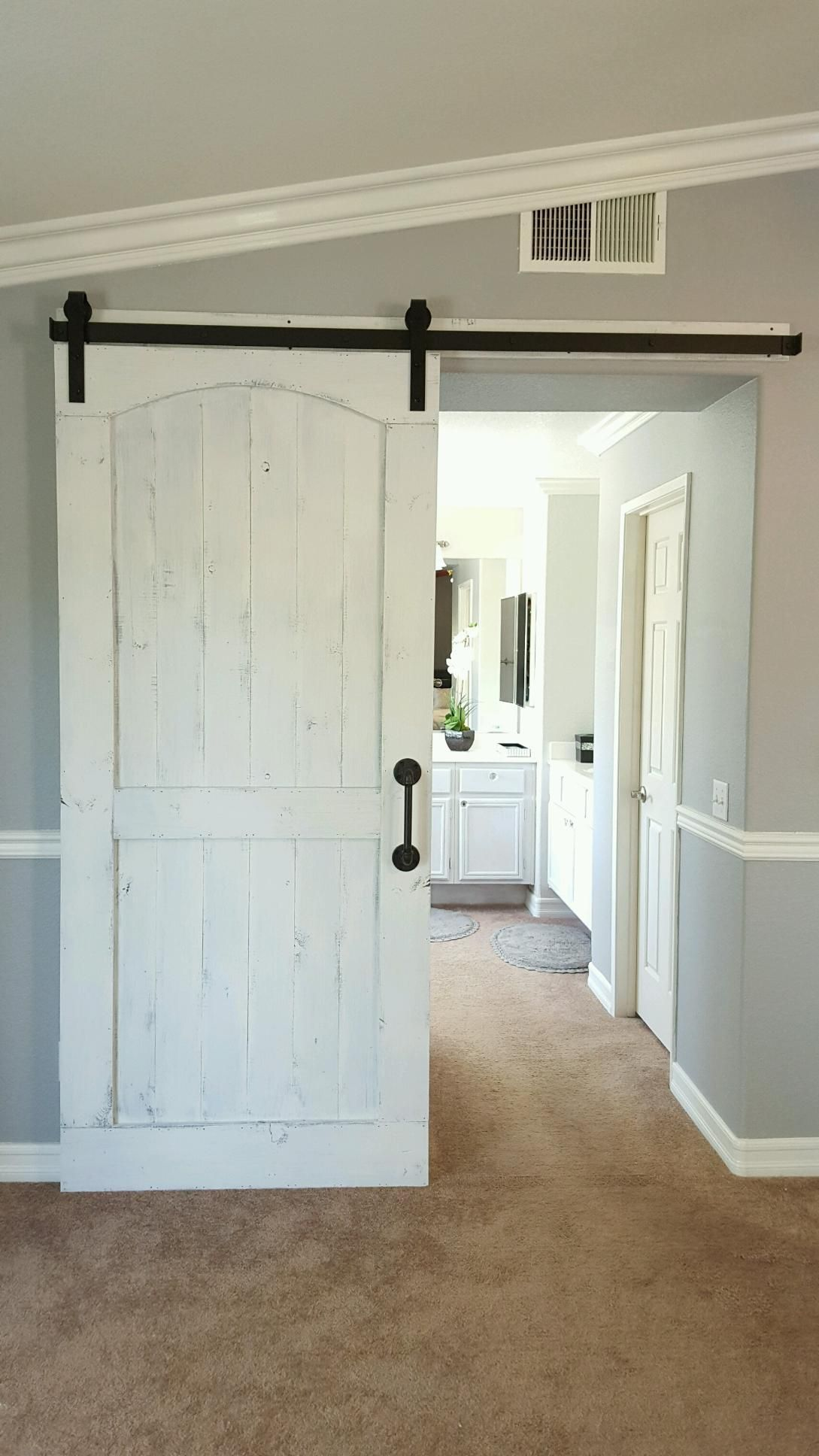Distressed White Barn Door With Hardware For A Master Bedroom Bathroom Houseremodelin Distressed White Bedroom Furniture Guest Bedroom Remodel Remodel Bedroom