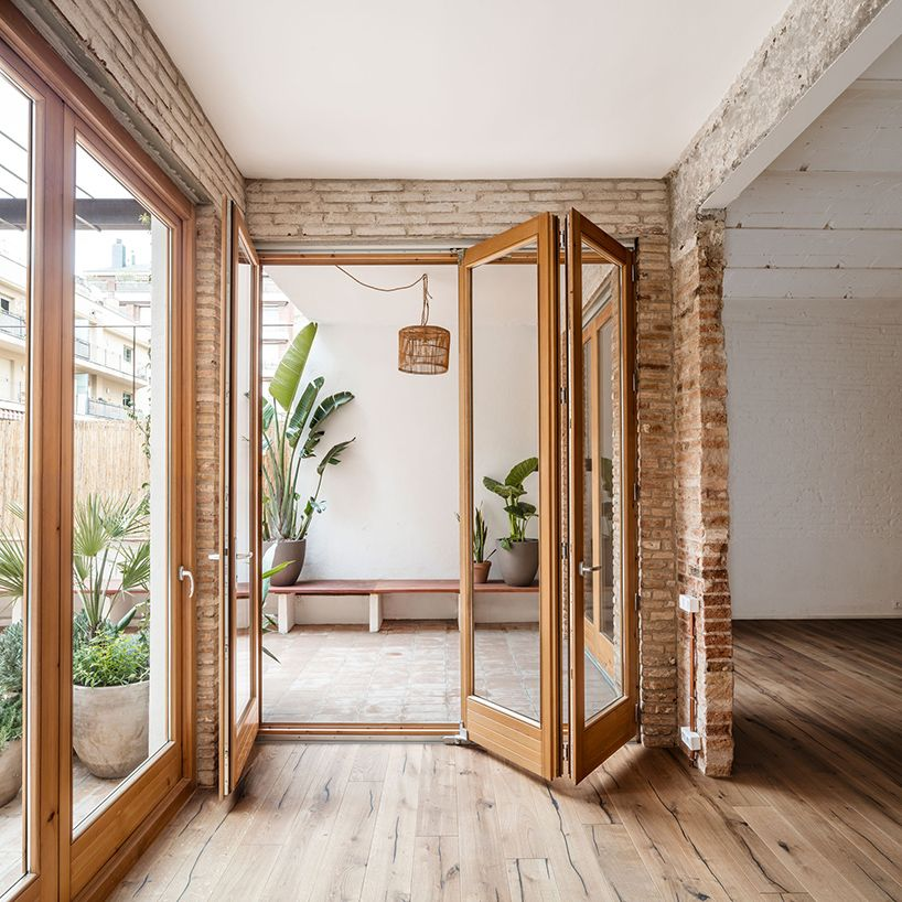 Photo of carles enrich intertwines patios with interiors for house in barcelona
