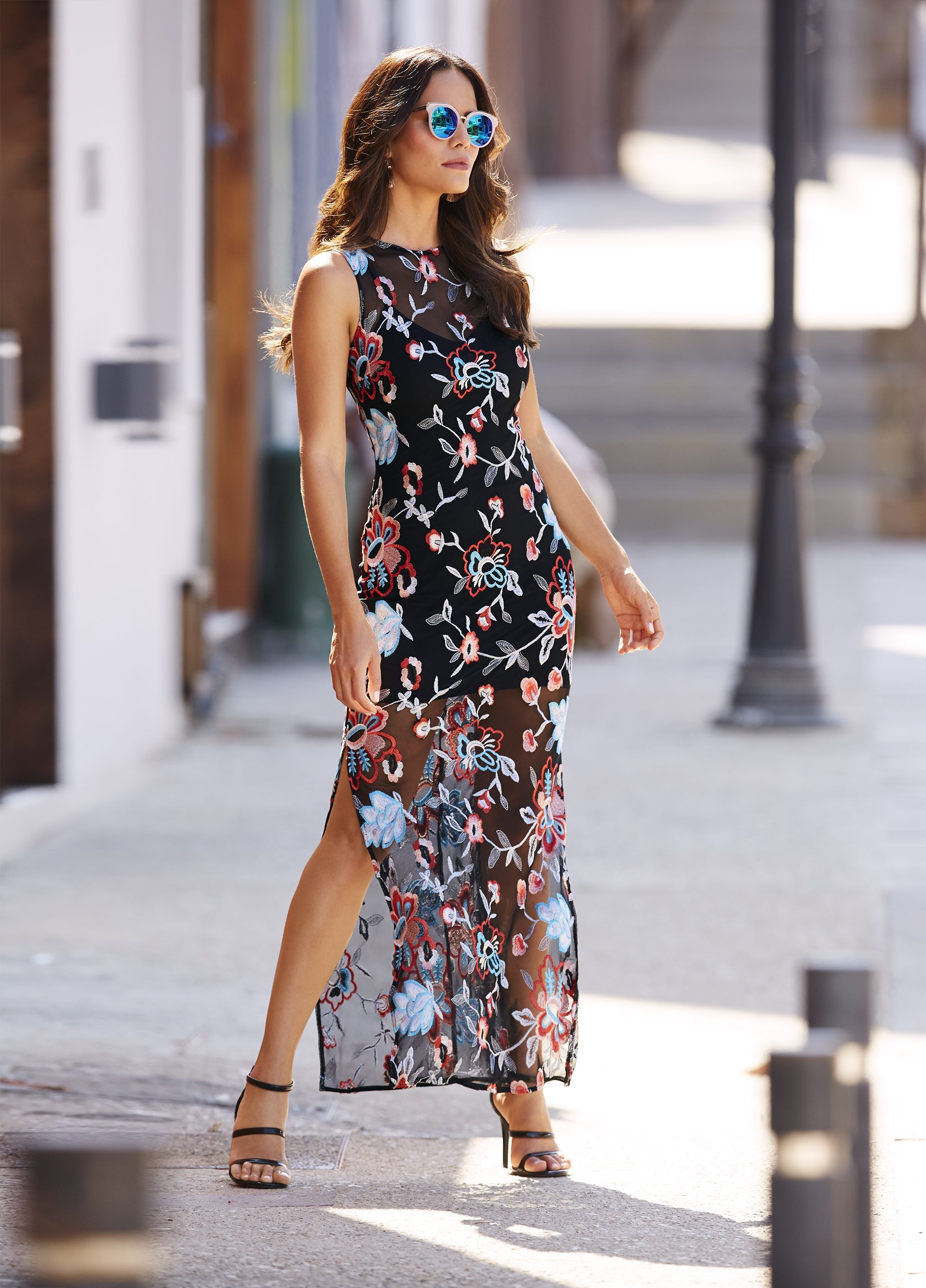 40e19e9f58a3 Sexy slits, colorful florals, and mesh details make this dress unforgettable.  #floral #mesh #meshdress #dress #floraldress