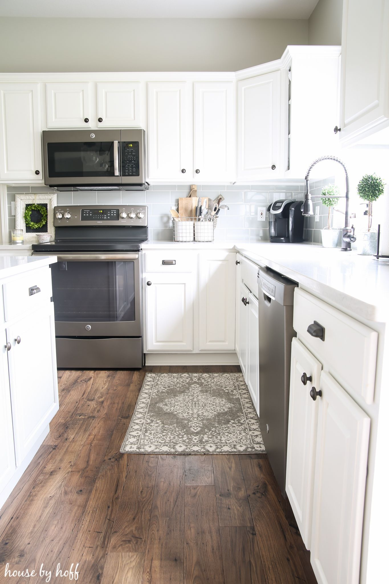 How Our Laminate Floors Are Holding Up Via House By Hoff Whitecabinets White Kitchen Decor House Flooring Kitchen Cabinets Decor