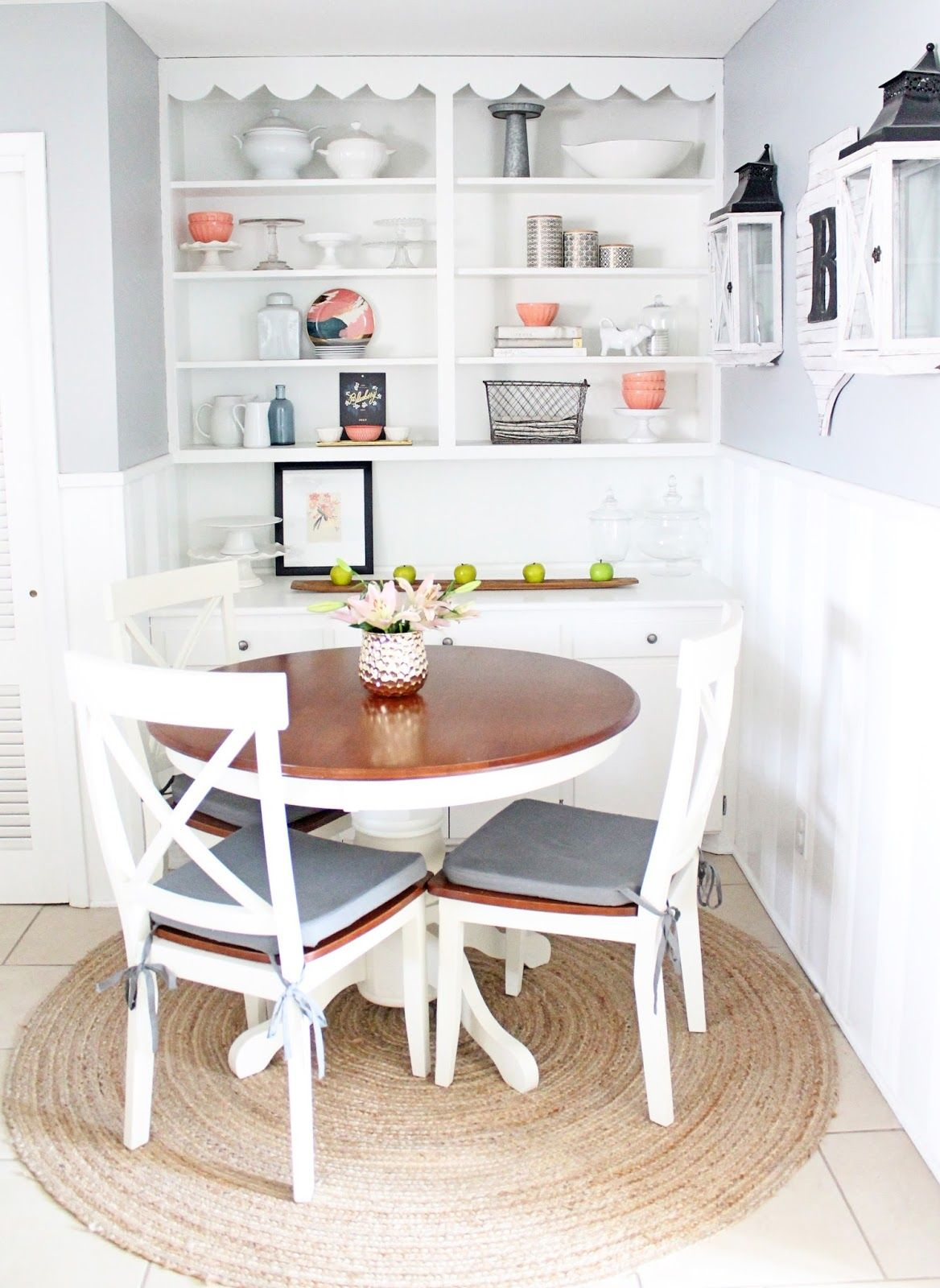 A modern farmhouse take on a breakfast nook with built-ins. Pops of peach