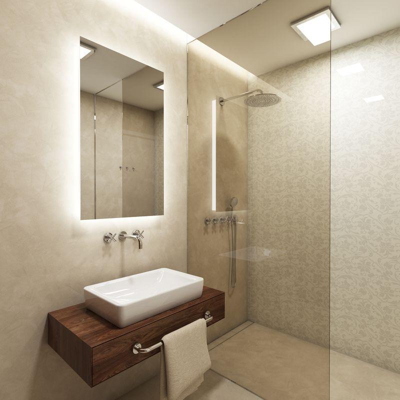Svetlé steny pridávajú kúpeľni opticky na centimetroch. Zaujímavé riešenie ponúka kombinácia stierky s dekoratívnym obkladom v sprchovacom k...