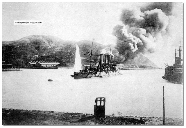 Imperial Russian ships in Port Arthur bombarded by Japanese howitzers during the Russo-Japanese War (日露戦争).