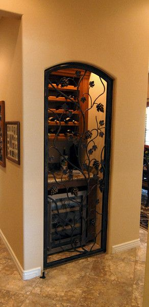 Turn a coat closet into a wine cellar. Love the black iron!