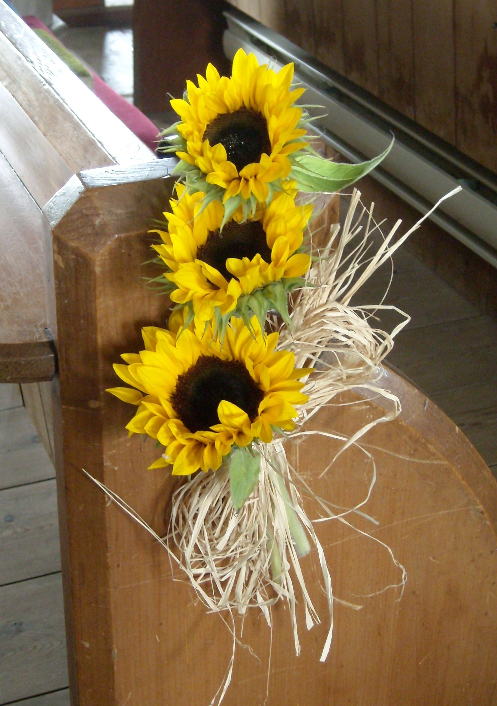 Sunflower and Raffia Pew end Wedding flowers, Wedding