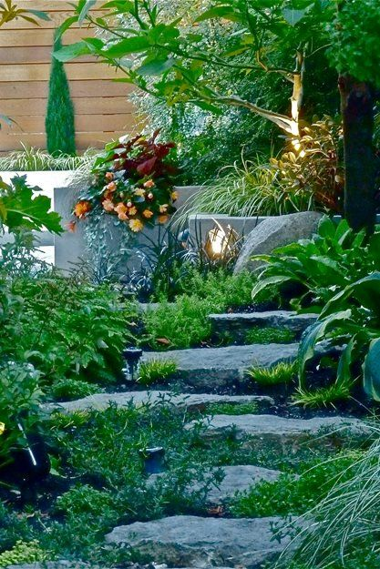 Sections of a garden are linked together with pathways ...