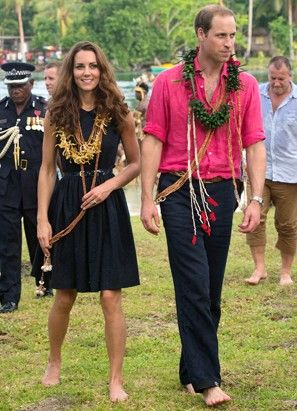 Kate Middleton and Prince William received a traditional welcome to the village of Marau before traveling to Tavanipupu Island as part of their southeast Asia tour. The Duke and Duchess of Cambridge received beaded necklaces before traveling in a war canoe to Tavanipupu. They walked barefoot as locals gave them a tour around the island. (Samir Hussein/Getty Images