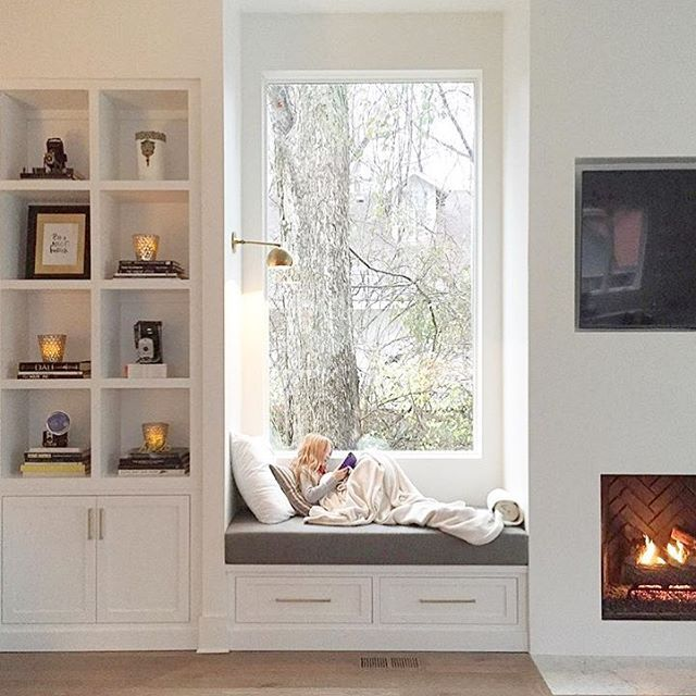 Bedroom Window Seat fireplace, window seat with drawers under, bookshelf with doors