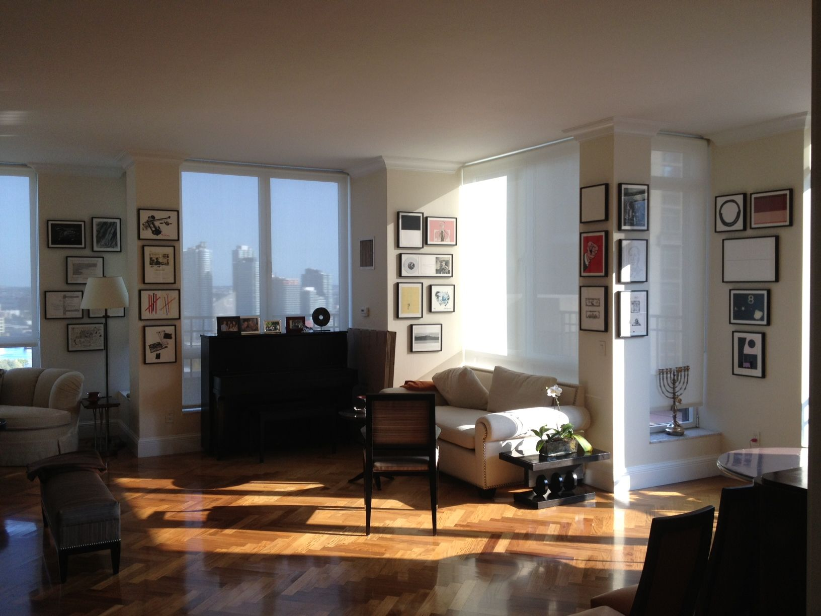 A Gallery Wall Around Windows In A Nyc Apartment