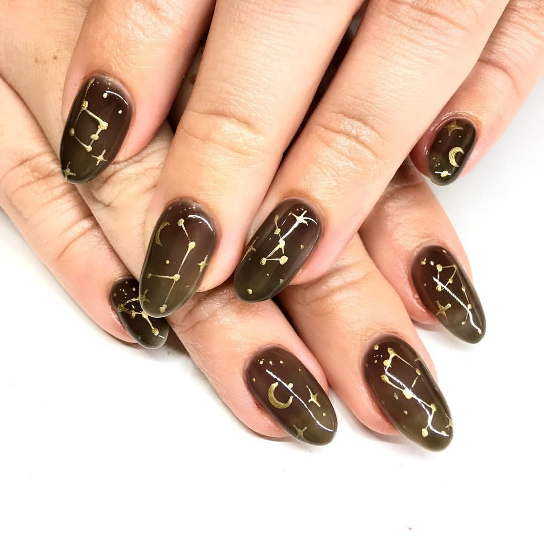 Constellation And Galaxy Nail Art Are Super Perfect For Moody Winter Time Sheer Black Nails With Gold Cons Subtle Nails Fall Nail Art Designs Subtle Nail Art