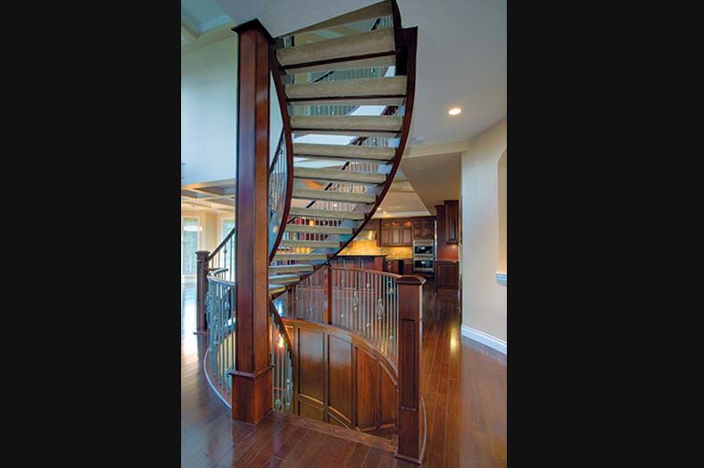 Best Open Riser Curved Staircase With Carpet By Shane Homes In 400 x 300