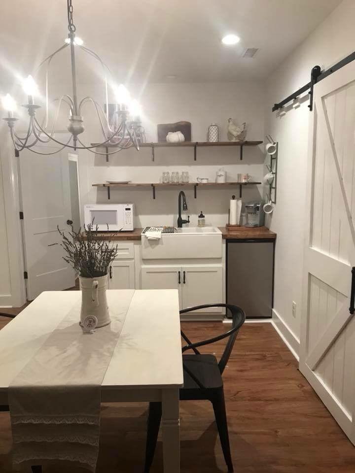 Farmhouse basement remodel open shelves wood countertop