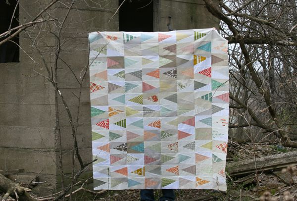 tutorial for triangle blocks here: http://www.filminthefridge.com/2011/10/12/scrappy-triangles-a-quilt-block-tutorial/