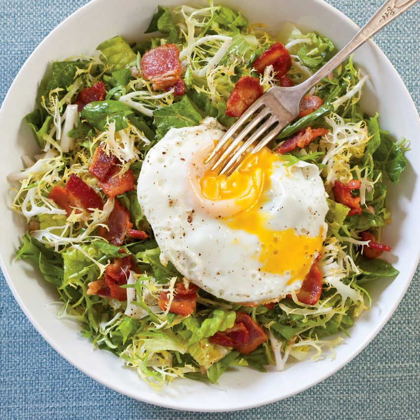 Thick-cut bacon and a fried egg add heft to these greens, turning a quick salad into supper.