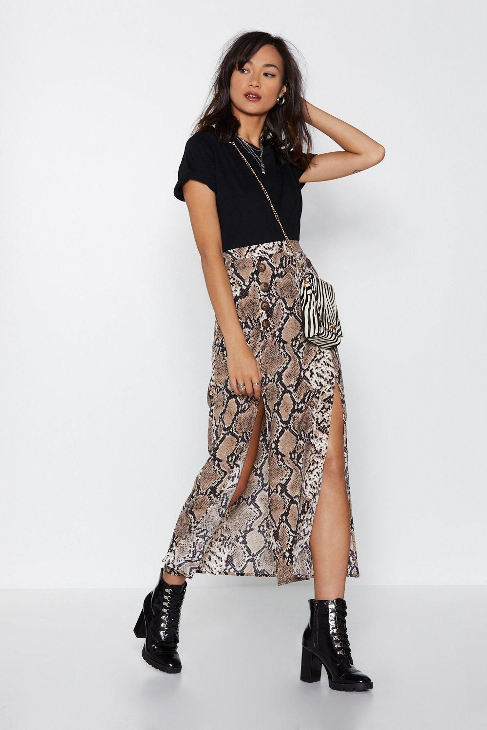 fc953dc262 This skirt features a maxi, high-waisted silhouette, slits at front, and  snake print.