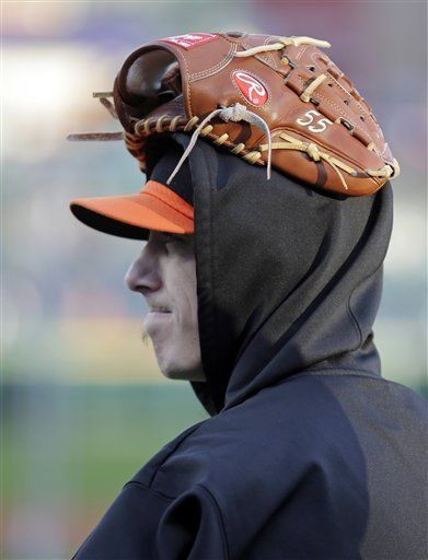 World Series Tigers Giants Baseball  Tims head is cold. 2 hats, hood and glove. Stay warm man.