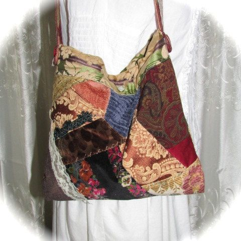 Lots of character and texture in this small patchwork purse! This granny bag was handmade in a crazy patchwork quilt style. Selected patchwork pieces