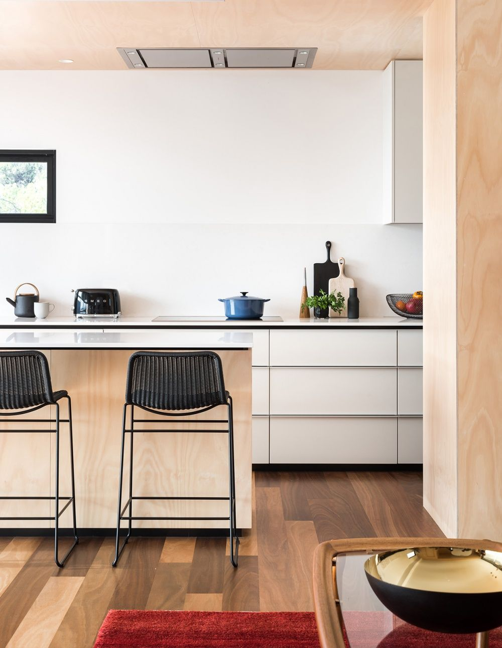 The galley style kitchen has framed views up into the coastal heath of the leeuwin
