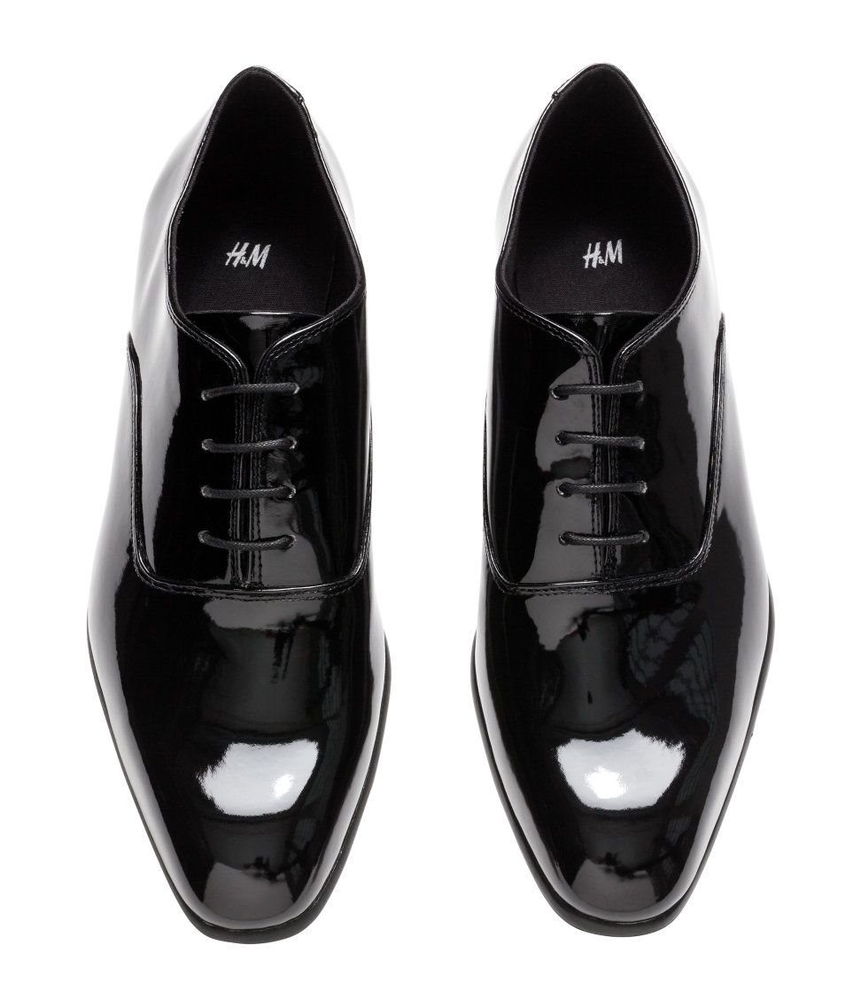 3417125ae6d Look sharp from head to toe with these black patent tuxedo shoes with  Oxford styling.