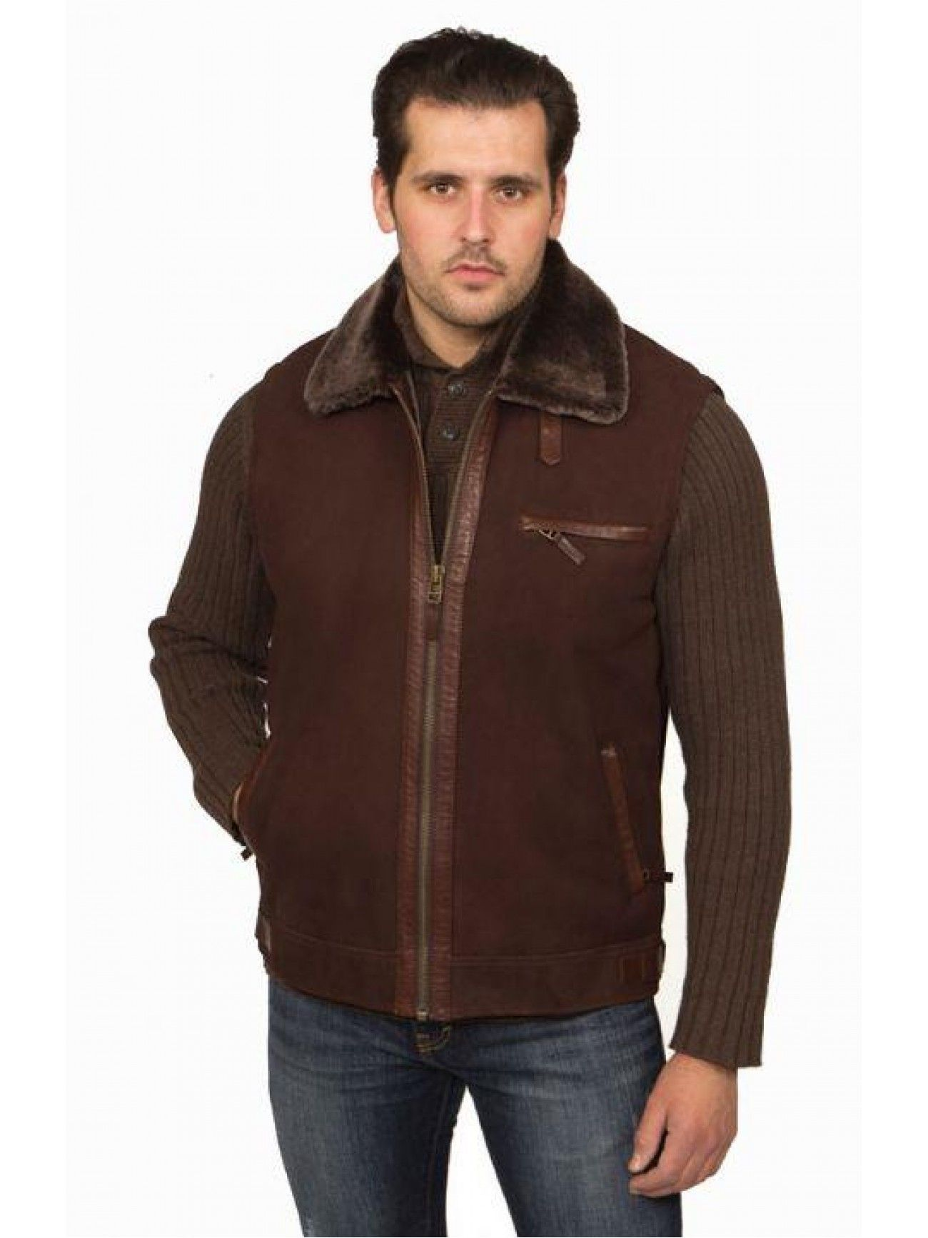 Field Shearling Vest Men`s Shearling vest with front zipper closure and slash side pockets. Lambskin trim on the edges of the collar, armhole and underneath the storm flap.