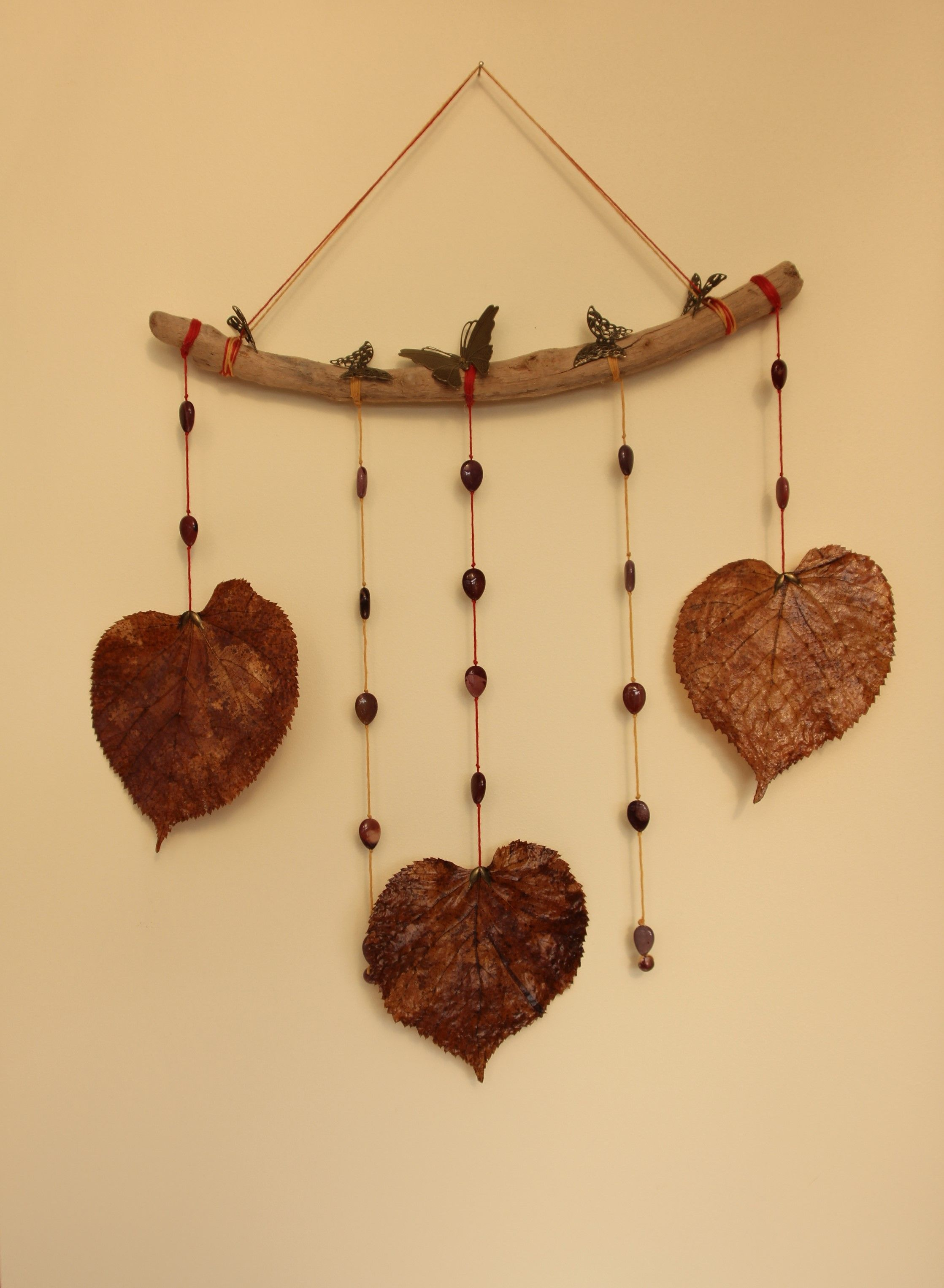A lovely mobile or wall hanging. Comprising of a curved piece of ...