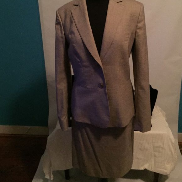 Beige suit  to dress for success position. Beige jacket with matching skirt to take you to a new job or a Dress for Success position. Jackets & Coats