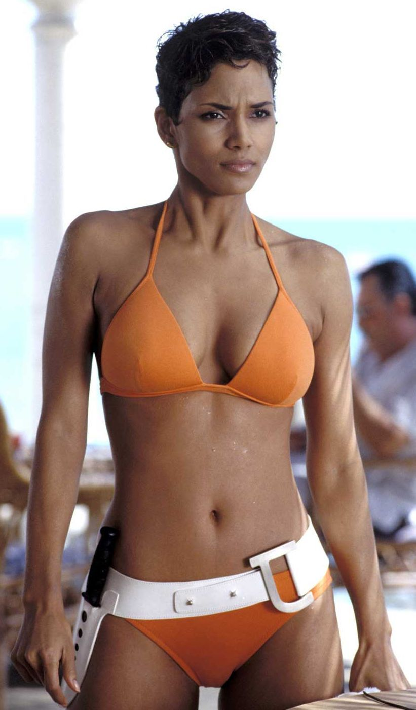 c4b7ca05c7af7 Halle Berry wore a blazing orange swimsuit by Eres in