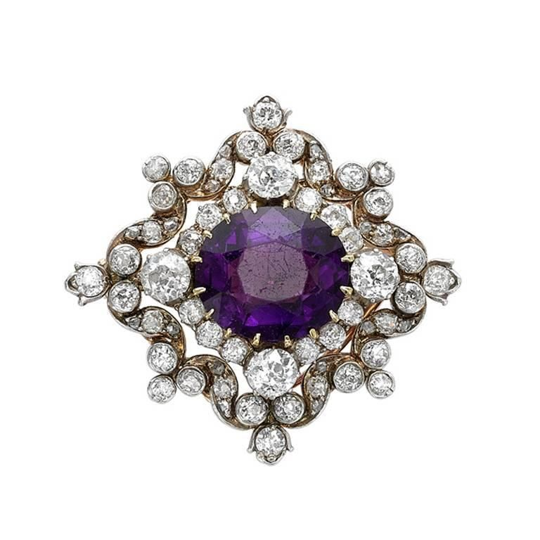 Yellow and White Gold Amethyst and Diamond Pendant/Brooch |       Victorian brooch pendant with central claw set amethyst and old cut diamond shoulders set in yellow and white gold.|             From a unique collection of vintage pendant necklaces at https://www.1stdibs.com/jewelry/necklaces/pendant-necklaces/