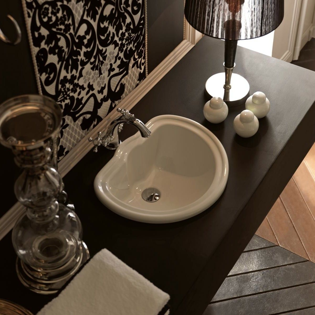 Designer high-end luxury ceramic drop-in bathroom sink.