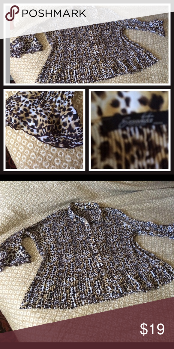 Animal print plus size blouse Very stylish and comes from a smoke free home . In a size 3X from ESSENTIAL BRAND . The sleeves have allot of detail  very stretchy . Essential Tops Button Down Shirts