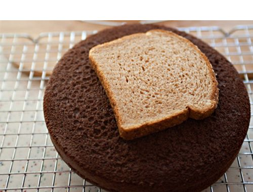 Pre-bake your cakes and keep them fresh overnight by placing a slice of bread on top. In the morning your bread will be hard as a rock but the cake will remain moist, ready to ice