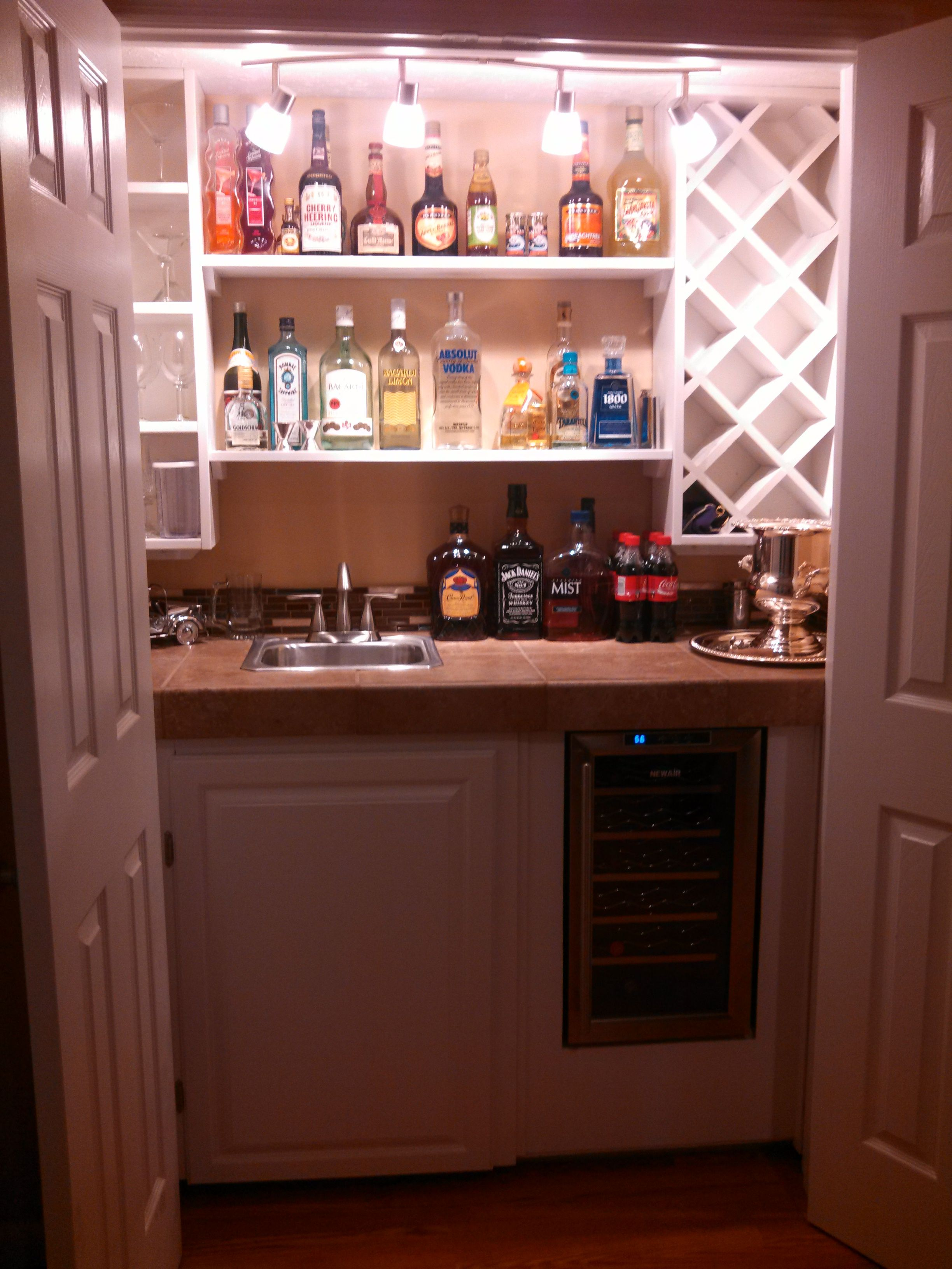 Built In Wet Bar Except Cabinet At Top So Alcohol Is Hidden