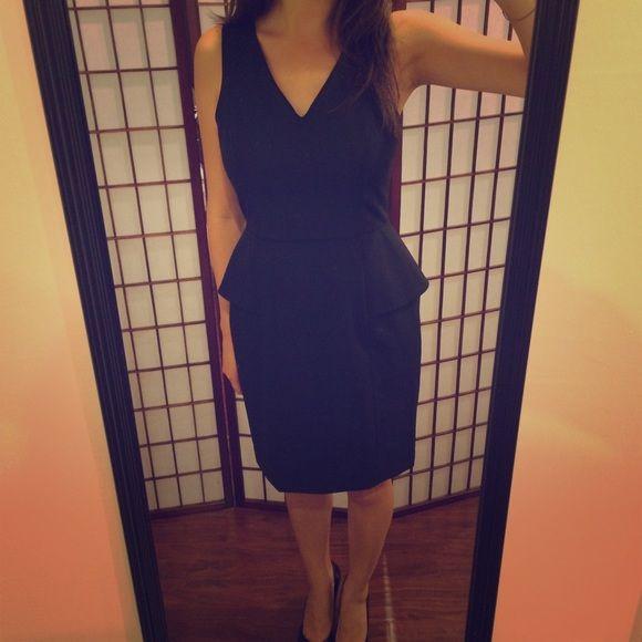 REDUCED!!! NWT Banana Republic Black Peplum Dress Simple & classy black dress. A must-have for any woman's closet! - Size 4 Petite - 95% wool, 5% spandex Shell Banana Republic Dresses