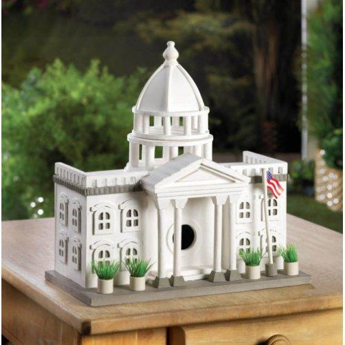 "A stately manor that your feathered friends will gladly vote to make their home! This fantastically detailed bird house looks like a miniature White House, complete with a waving American flag and potted plants outside. Hang this presidential bird palace in your yard and watch as birds flock to it.  Item weight: 2.8 lbs. 11 1/2"" x 7"" x 12 3/4"" high. Wood. Some Assembly Required"