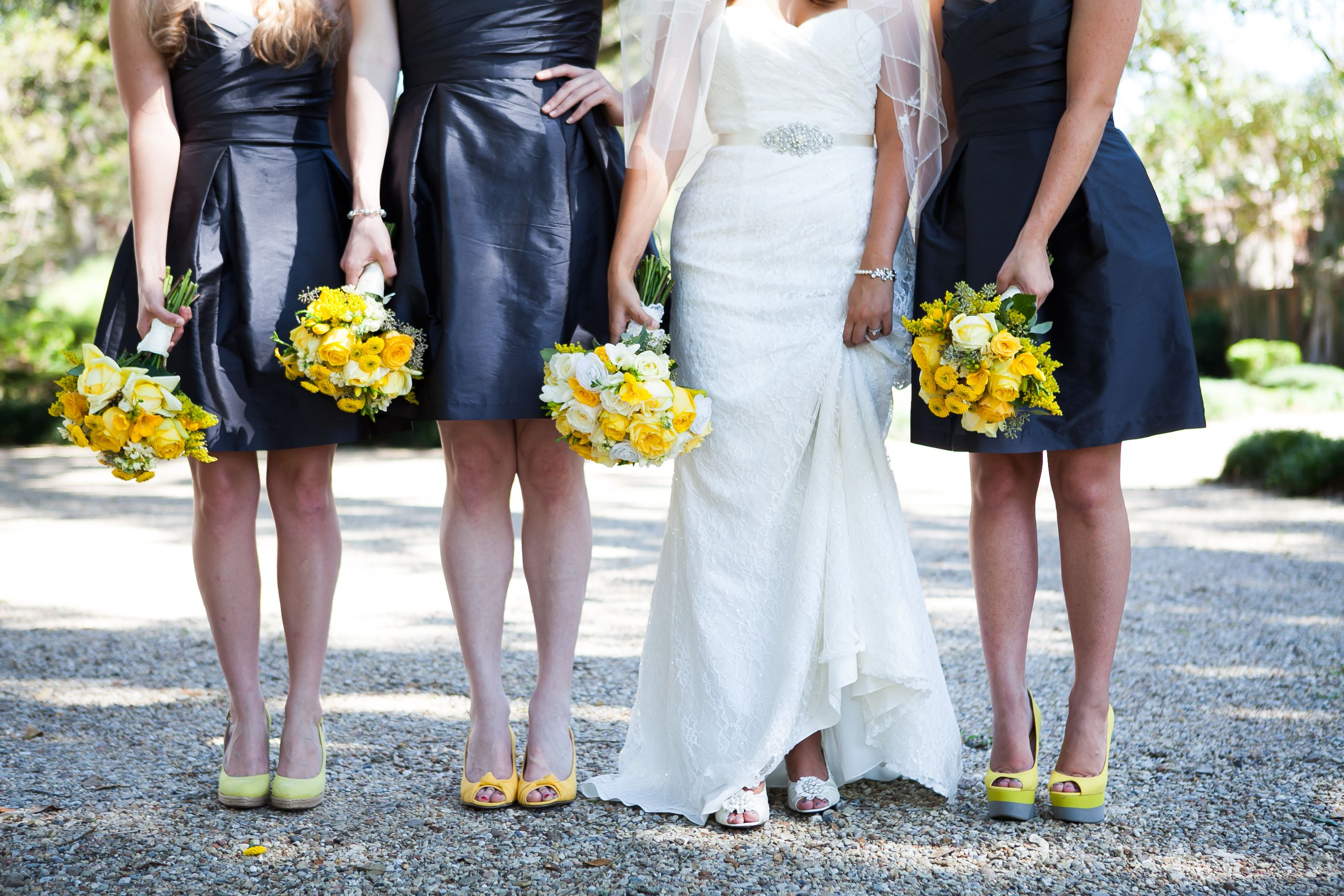 Charcoal bridesmaids dresses with yellow bouquets and yellow shoes
