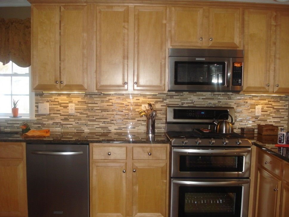 Fresh Backsplash with Oak Cabinets and Dark Countertops