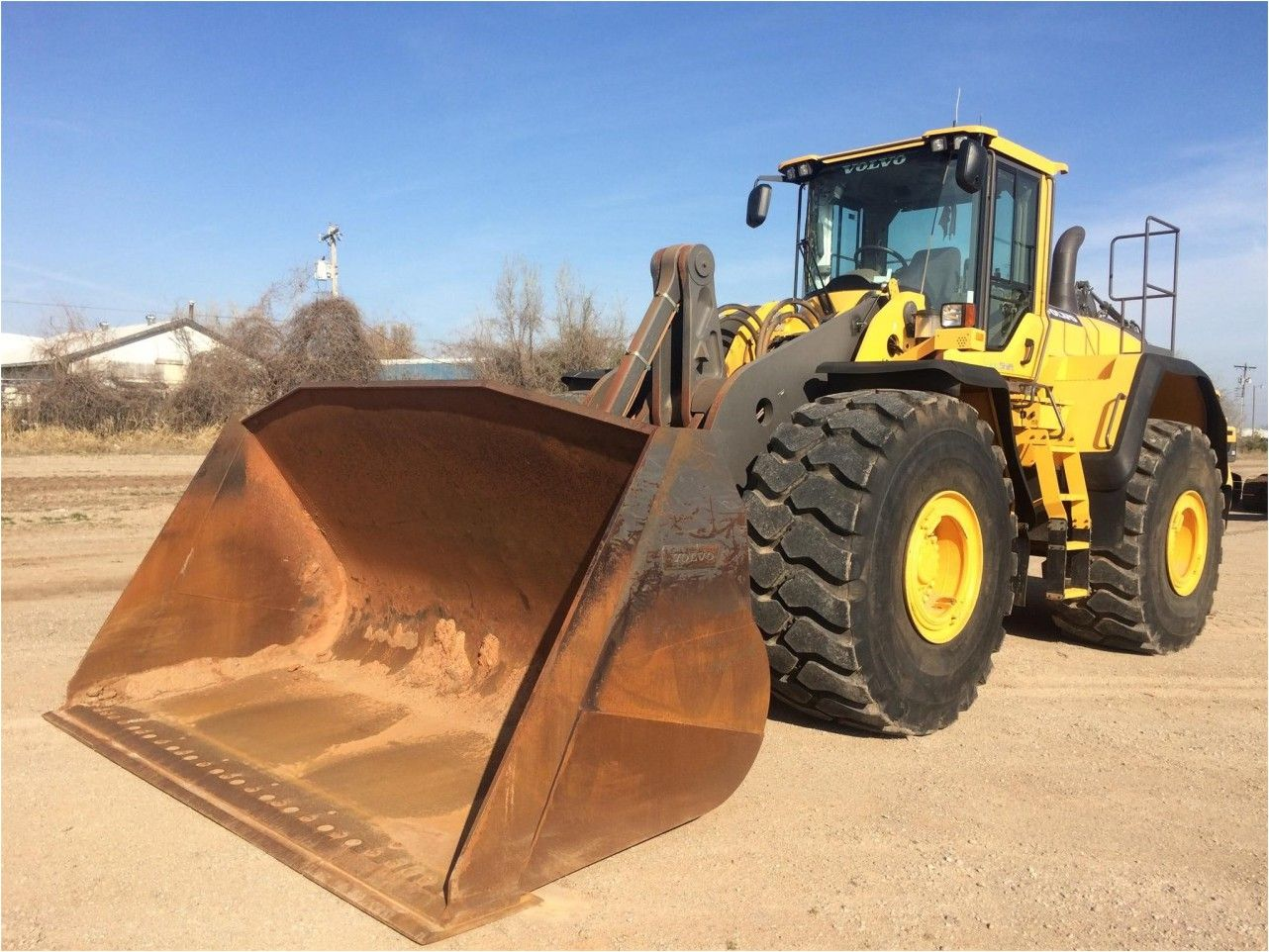 Our Featured Wheel Loader is a 2014 Volvo L220G, ROPS Cab