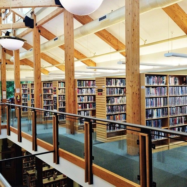 We love visiting #libraries on vacation! This adorable one is in Port Carling, Ontario. Look at all that sunlight!