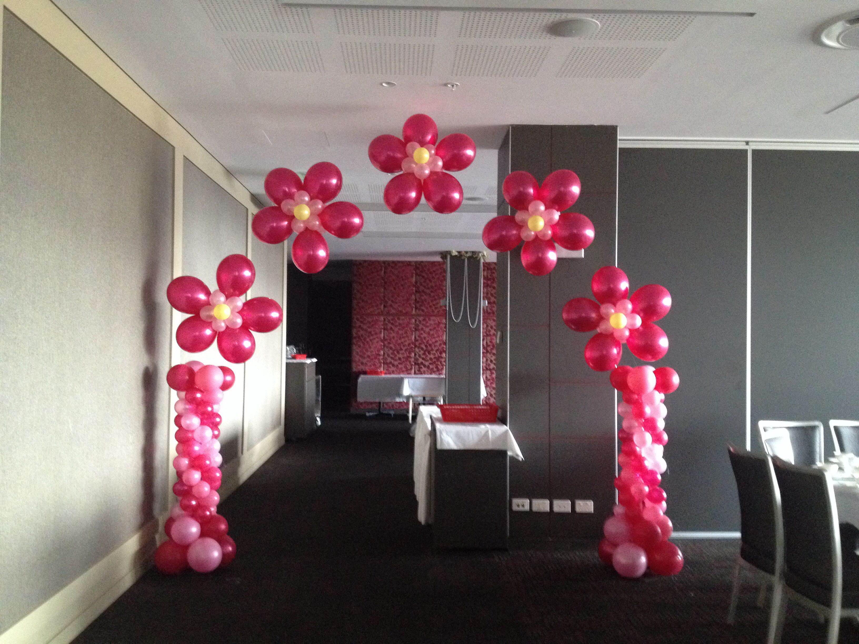 Helium flower arch with mini Corinthian columns for a baby shower ...