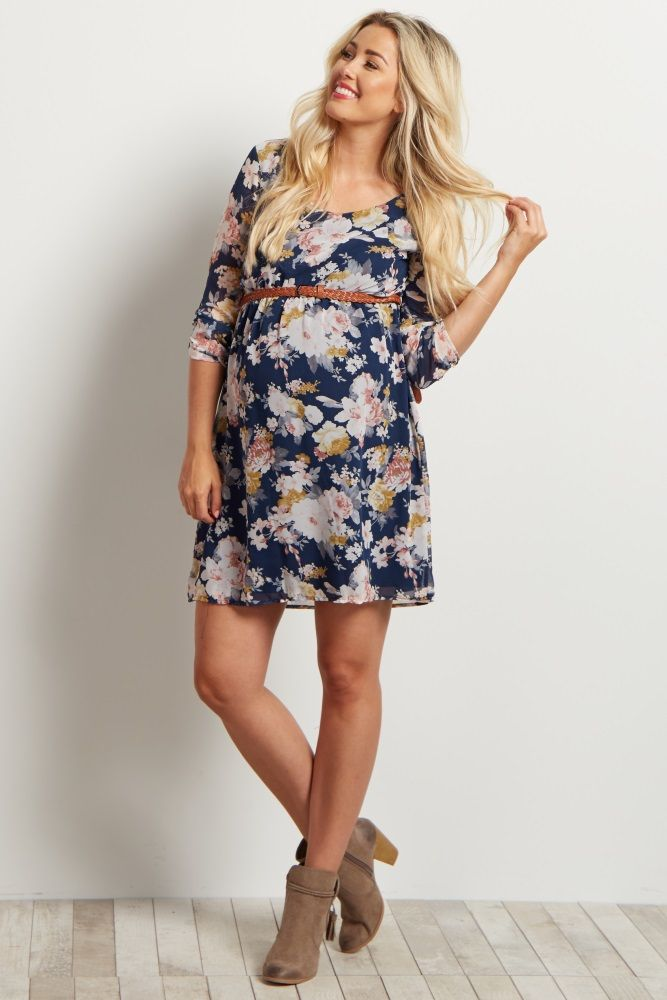 fa70436d7663b A floral printed chiffon belted maternity dress. 3/4 sleeves. Rounded  neckline. Double lined to prevent sheerness. Cinched under bust.