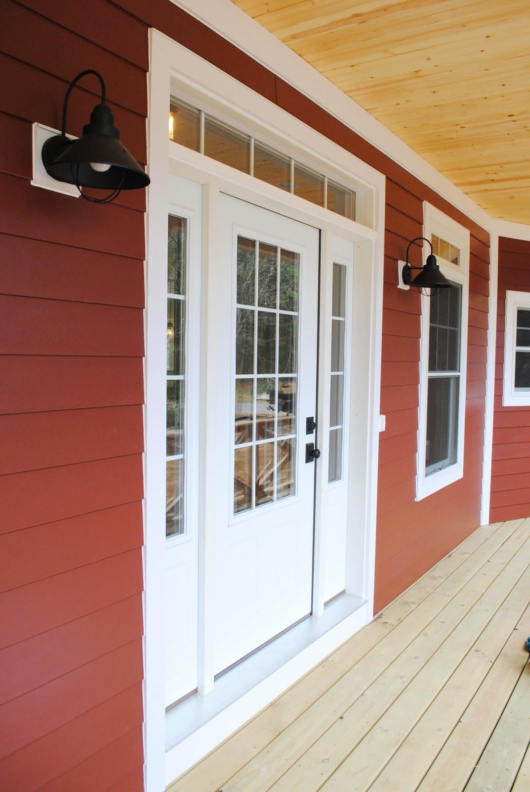 Front door with sidelights and transom - Exterior Countrylane Red Siding By James Hardie Black Barn Lights 3