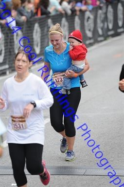 Feel like a trooper in this picture. Carried my boy across the finish line after 13.1 miles without him :)